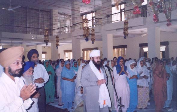 Amrit Pal Singh 'Amrit' performing prayer in Gurdwara